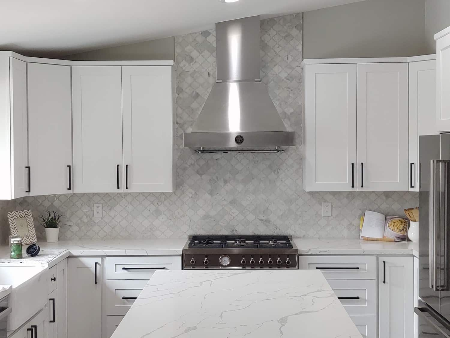 White kitchen cabinets and countertops as part of a remodel in Tucson