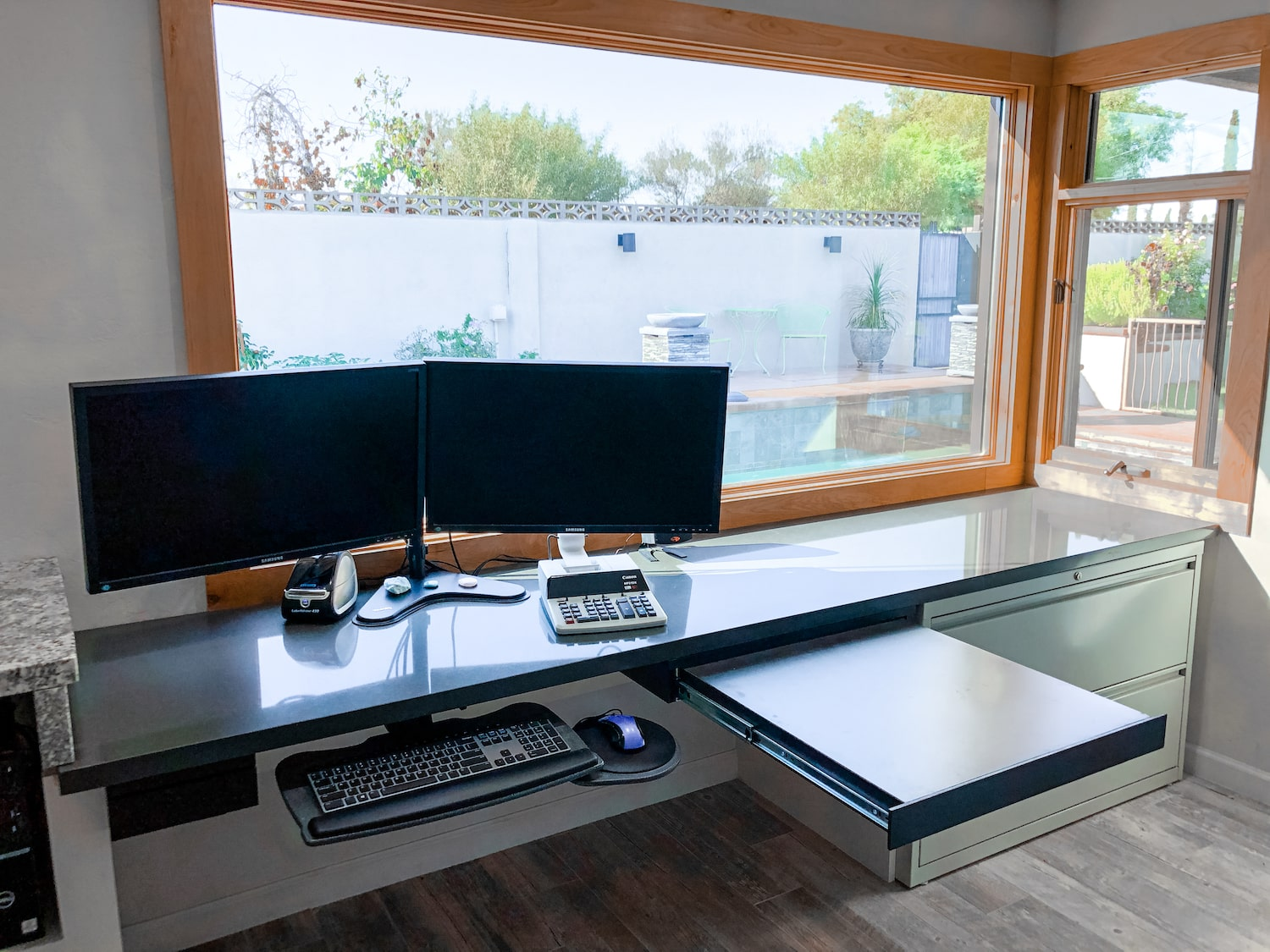 A remodeled home office in Tucson with a large window letting in natural light